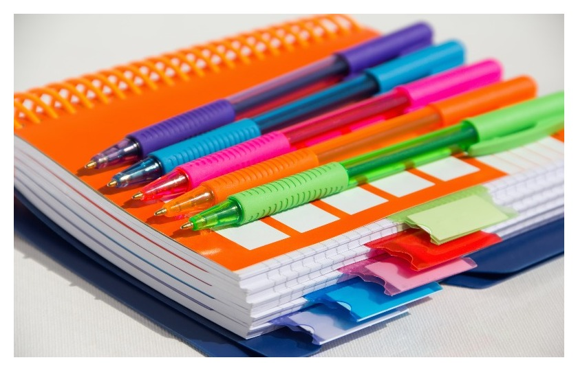 Stack of colored notebooks.